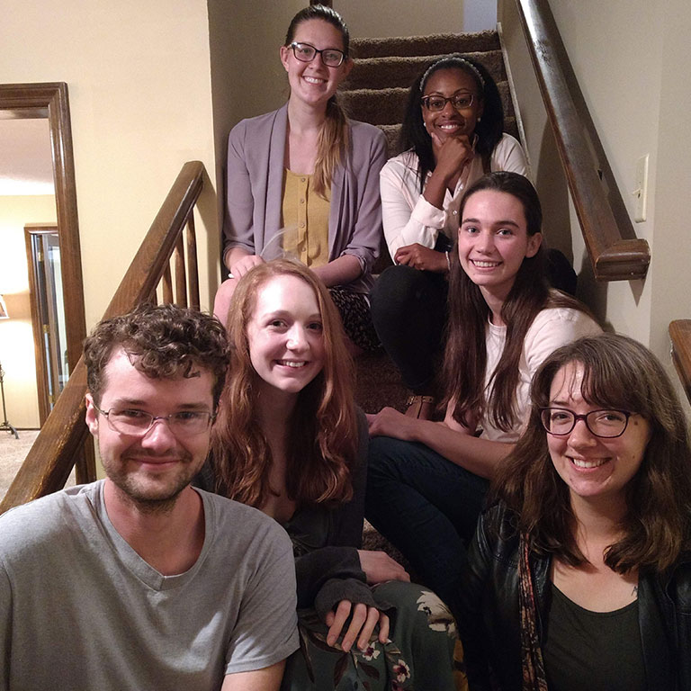 M.A. graduate students sit on stairway